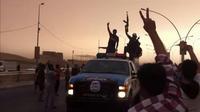 Capture d'écran d'une vidéo publiée sur YouTube le 12 juin 2014 montrant des membres présumés de l'EIIL paradant dans une rue de Mossoul   [- / YouTube/AFP/Archives]
