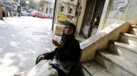 Une Syrienne mendie dans les rues de Beyrouth le 29 août 2014 après avoir fui son pays [Anwar Amro / AFP]