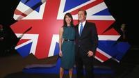 Le Premier ministre britannique David Cameron et son épouse Samantha à la convention annuelle du parti conservateur à Manchester le 2 octobre 2013 [Oli Scarff / Pool/AFP]