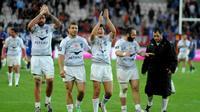 Les joueurs de Montpellier à la fin de leur match contre Grenoble en Top 14, le 12 avril 2014 au stade des Alpes [ / AFP]