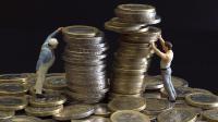 Des figurines et des euros [Joël Saget / AFP/Archives]