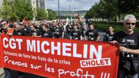 Des salariés de Michelin manifestent dans les rues de Clermont-Ferrand, le 26 juin 2013 [Thierry Zoccolan / AFP]