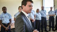 Manuel Valls visite la gendarmerie d'Aurillac, le 22 août 2013 [Jeff Pachoud / AFP]