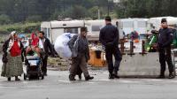 Evacuation par la police d'un campements de Roms, le 18 septembre 2013 à Lille [Denis Charlet / AFP]