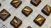 Des chocolats aux grillons, chez le chocolatier Sylvain Musquar, à Villers-lès-Nancy, le 12 octobre 2013 [Jean-Christophe Verhaegen / AFP]