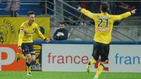 Sébastien Corchia (G) jubile après avoir inscrit un but contre Montpellier lors de la Copupe de la Ligue, le 30 octobre 2013 à Sochaux [ / AFP]