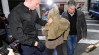Jérémy Rimbaud  amené par des gendarmes le 20 décembre 2013 au Tribunal de Pau  [Gaizka Iroz  / AFP]