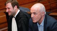 L'ex-footballeur et entraîneur Gilbert Bodart, un des prévenus, assistant au procès, le 3 février 2014 [ / BELGA/AFP]