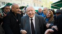 -Le maire sortant Jean-Claude Gaudin lors d'une visite le 28 mars 2014 dans le quartier de Noailles à Marseille  [Bertrang Langlois  / AFP/Archives]