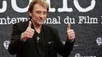 Johnny Hallyday au Festival international du film policier à Beaune, le 2 avril 2014 [Jean-Philippe Ksiazek / AFP/Archives]