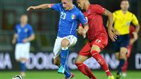 Le milieu de terrain italien Marco Verratti (g) lors du match de préparation au Mondial face au Luxembourg, le 4 juin 2014 à Pérouse [Alberto Pizzoli / AFP]