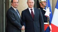 François Hollande (g) et Vladimir Poutine au palais de l'Elysée à Paris, le 5 juin 2014 [Pierre Andrieu / AFP]