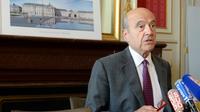 Alain Juppé, maire de Bordeaux et membre du triumvirat chargé provisoirement de la direction de l'UMP, lors d'une conférence de presse le 23 juin à Bordeaux [Mehdi Fedouach / AFP/Archives]