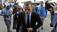 L'athlète paralympique sud-africain Oscar Pistorius arrivant au tribunal à Pretoria pour la reprise son procès le 7 juillet 2014 [Antoine de Ras / POOL/AFP]