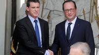 François Hollande et Manuel Valls à la sortie du dernier séminaire gouvernemental avant la pause estivale, le 1er août 2014 au Palais de l'Elysée [Dominique Faget / AFP]