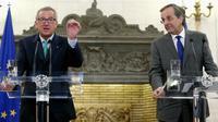 Jean-Claude Juncker (g), le nouveau  président de la Commission européenne et le Premier ministre grec Antonis Samaras à Athènes le 4 août 2014  [Panagiotis Tzamaros / AFP]
