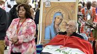 Un Irakien catholique assiste aux fêtes de l'Assomption à Lourdes le 15 août 2014 [Pascal Pavani / AFP]