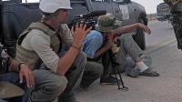 James Foley (G) le 29 septembre 2011 à Sirte en Syrie [Aris Messinis / AFP/Archives]