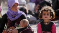 Une femme yazidi avec ses enfants dans le camp de réfugiés de Bajid Kandala au Kurdistan irakien, le 13 août 2014  [Ahmad Al-Rubaye / AFP]