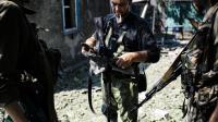 Des rebelles pro-russes le 22 août 2014 à Donetsk [Dimitar Dilkoff / AFP]