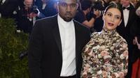 Le rappeur Kanye West et Kim Kardashian le 6 mai 2013 à New York [Timothy A. Clary / AFP/Archives]