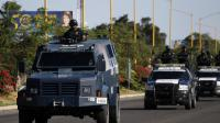 La police fédérale mexicaine patrouille dans les rue d'Apatzingan, dans l'ETat de Michoacan, le 14 janvier 2014 [Hector Guerrero / AFP]