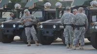 Les militaires de la Garde nationale déployés le 18 août 2014 à Ferguson [Michael B. Thomas / AFP]