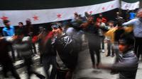 Manifestation contre le régime de Bachar al-Assad à Alep, le 22 mars 2013 [Bulent Kilic / AFP]