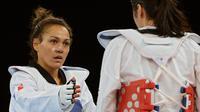 La Française Anne-Caroline Graffe s'est qualifiée pour les demi-finales de taekwondo en plus de 67 kg en battant en quarts de finale la Sud-Coréenne Lee In-jong, samedi aux jeux Olympiques de Londres.[AFP]