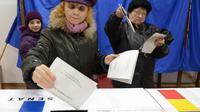 Opération de vote le 9 décembre 2012 à Bucarest [Daniel Mihailescu / AFP]