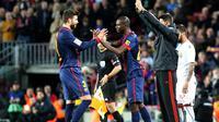 L'entrée d'Eric Abidal (au centre) du FC Barcelone lors du match conte Majorque le 6 avril 2013 à Barcelone [Quique Garcia / AFP]