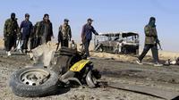 Le lieu d'un attentat contre un convoi de pèlerins chiites en route, à Mastung, près de Quetta, le 30 décembre 2012 [Banaras Khan / AFP]