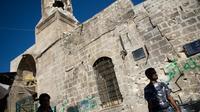 Prise entre insurgés et troupes fidèles au président syrien Bachar al-Assad, la ville d'Alep s'inquiète pour son patrimoine historique unique, qui de balles d'armes automatiques en obus de mortier, subit des dommages inouïs.[AFP]