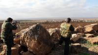 Des soldats syriens pointent leurs fusils sur Deraa le 23 janvier 2013 [Anwar Amro / AFP]