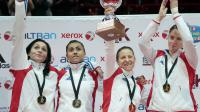 Les karatekas françaises Lolita Dona, Emilie Thouy, Alexandra Recchia et Tiffany Fanjat (g à d) célèbrent leur médaille d'or en combat le 25 novembre 2012 aux championnats du monde de Paris-Bercy [Jacques Demarthon / AFP]
