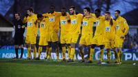 L'équipe d'Epinal réunis après leur victoire contre Lyon en 32e de finale de Coupe de France, le 6 janvier 2013 à Epinal [Sebastien Bozon / AFP]
