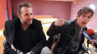 Jean Dujardin (g) et le réalisateur Eric Rochant en conférence de presse pour la présentation du film Möbius, le 15 février 2013 à Rennes [Jean-Francois Monier / AFP/Archives]