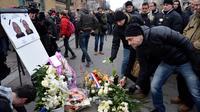 Hommage aux deux policiers tués, le 26 février 2013 à Paris [Eric Feferberg / AFP]