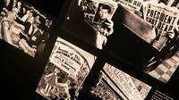 Photo du 26 septembre 2013 montrant des photos avec des Unes de journaux après l'assassinat du président américain John F. Kennedy lors d'une exposition au Newseum de Washington [BRENDAN SMIALOWSKI / AFP/Archives]