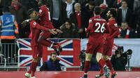 Roberto Firmino (g) auteur d'un triplé pour Liverpool lors de la victoire face à Arsenal 5-1 le 29 décembre 2018 [Paul ELLIS / AFP]