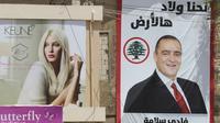 Photo d'une affiche électorale prise dans la localité méridionale de Marjayoun le 5 mai 2018, à la veille des élections législatives libanaises [Mahmoud ZAYYAT / AFP]