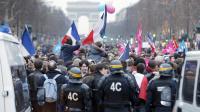 La police face à des manifestants opposés à la loi sur le mariage homosexuel, le 24 mars 2013 sur les Champs Elysées à Paris [Pierre Verdy / AFP/Archives]