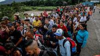 Des Vénézueliens attendent à la frontière à San Antonio del Tachira pour entrer à Cucuta, le 9 juin 2019 en Colombie, [Schneyder MENDOZA / AFP/Archives]