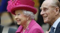La reine d'Angleterre Elizabeth II et son époux, le duc d'Edimbourg, le 22 octobre 2013 à Londres [Lefteris Pitarakis / Pool/AFP/Archives]