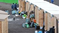 Des migrants et des réfugiés arrivent dans le premier camp français aux normes internationales à Grande-Synthe, dans le Nord, le 7 mars 2016 [FRANCOIS LO PRESTI / AFP/Archives]