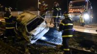 Véhicule incendié sur la voie ferrée le 20 octobre 2015 à Moirans près de Grenoble [PHILIPPE DESMAZES / AFP]