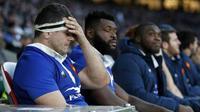 Les joueurs du XV de France,  dépités, lors de la défaite devant l'Angleterre en Six Nations à Twickenham, le 10 février 2019 [Adrian DENNIS / AFP]