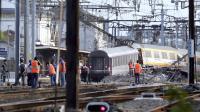 Des secouristes le 12 juillet 2013 dans la gare de Brétigny-sur-Orge après l'accident de train [Kenzo Tribouillard / AFP/Archives]
