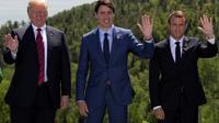 (g-d) le président américain Donald Trump, le Premier ministre canadien Justin Trudeau et le président français Emmanuel Macron, lors du sommet du G7 à La Malbaie, le 8 juin 2018 au Canada  [IAN LANGSDON/POOL / POOL/AFP]