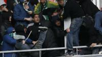 Des supporters stéphanois franchissent le parapet du parcage visiteurs à l'Allianz Riviera avant le match de L1 Nice-Saint-Etienne, le 24 novembre 2013